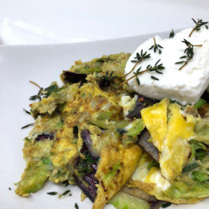 Herb and Brussels Sprout Egg Scramble with Goat Cheese Close Up