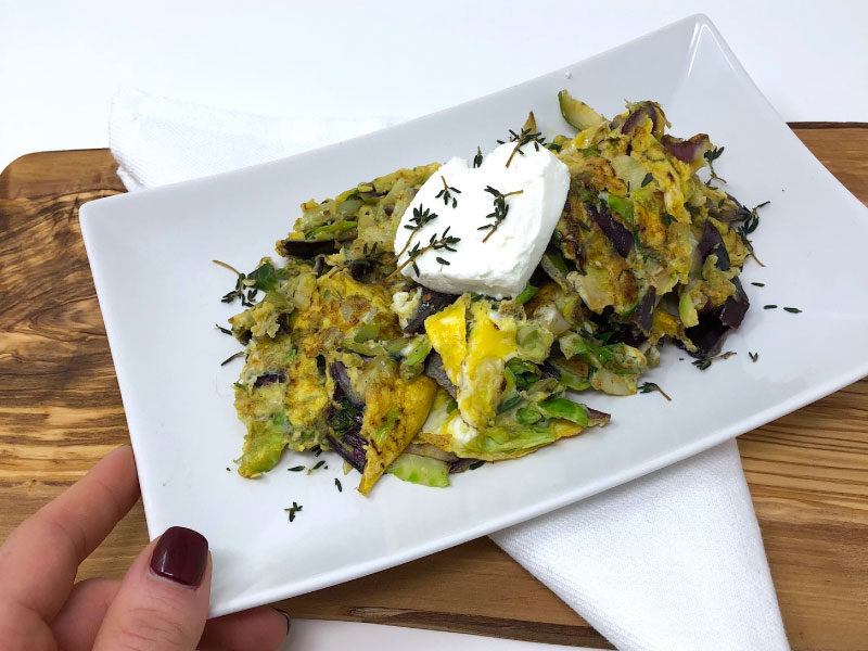 Herb and Brussels Sprout Egg Scramble with Goat Cheese