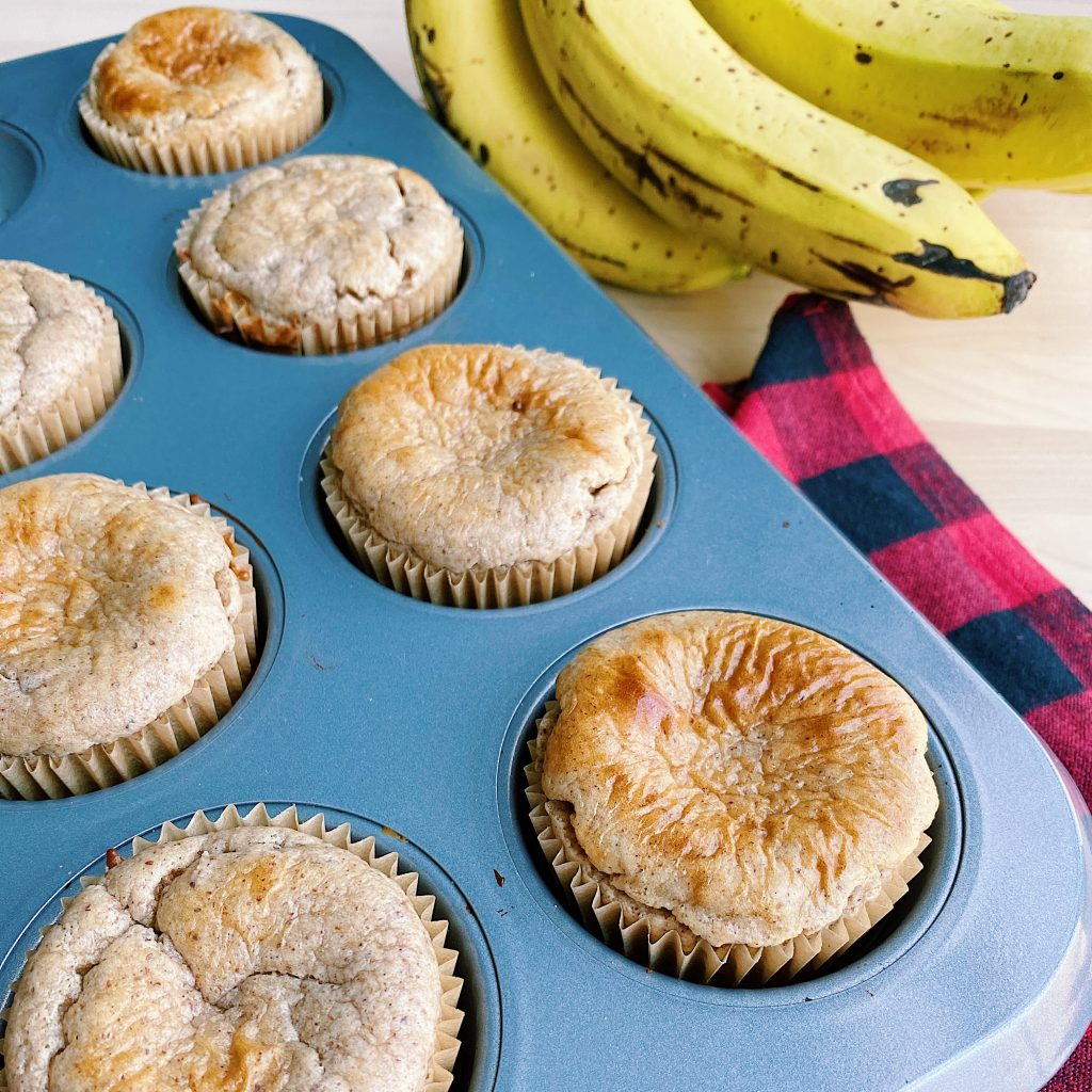 Ripe Bananas next to Banana Muffins