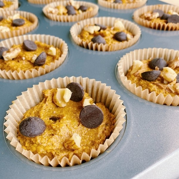 Uncooked pumpkin muffins with chocolate and walnuts