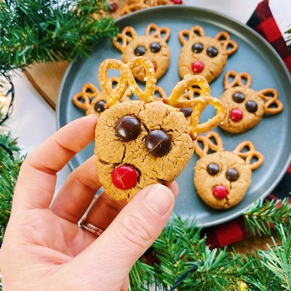 picking up a reindeer cookie