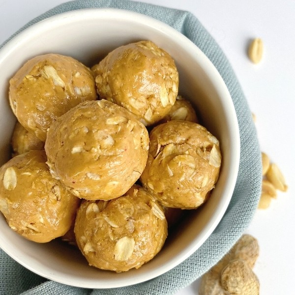 Bowl of peanut butter balls made with oats and honey