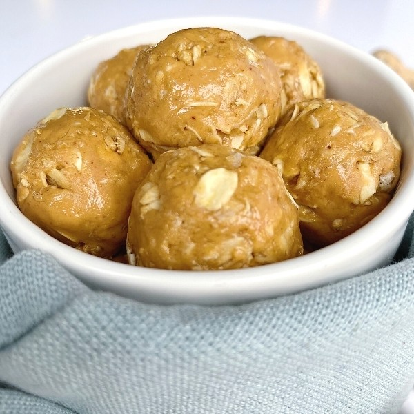 Close up of a bowl of easy peanut butter balls