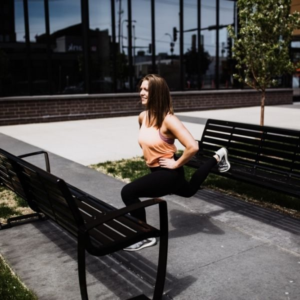 personal trainer on park bench